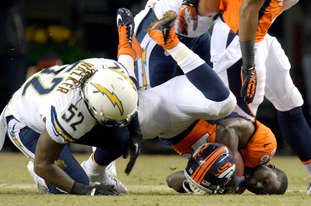 . DENVER, CO - DECEMBER 12: Denver Broncos running back Montee Ball (28) hits the turf without his helmet after being tackled by San Diego Chargers inside linebacker Reggie Walker (52) during the first quarter. The Denver Broncos vs. the San Diego Chargers at Sports Authority Field at Mile High in Denver on December 12, 2013. (Photo by John Leyba/The Denver Post)