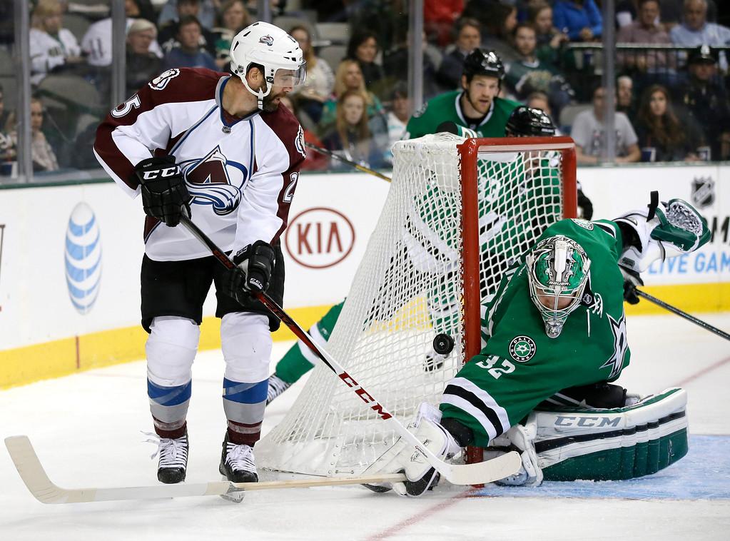 . Colorado Avalanche\'s Maxime Talbot (25) has his shot blocked by Dallas Stars goalie Kari Lehtonen (32), of Finland, in the second period of an NHL hockey game, Friday, Nov. 1, 2013, in Dallas. (AP Photo/Tony Gutierrez)