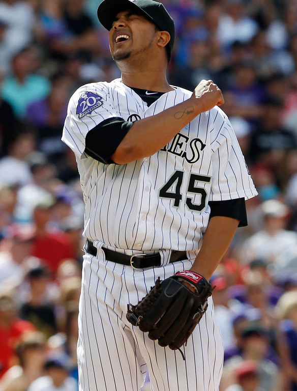 . Colorado Rockies starting pitcher Jhoulys Chacin reacts after giving up an RBI-double to Philadelphia Phillies\' Jimmy Rollins to break the shutout in the ninth inning of the Rockies\' 5-2 victory in a baseball game in Denver on Sunday, June 16, 2013. (AP Photo/David Zalubowski)