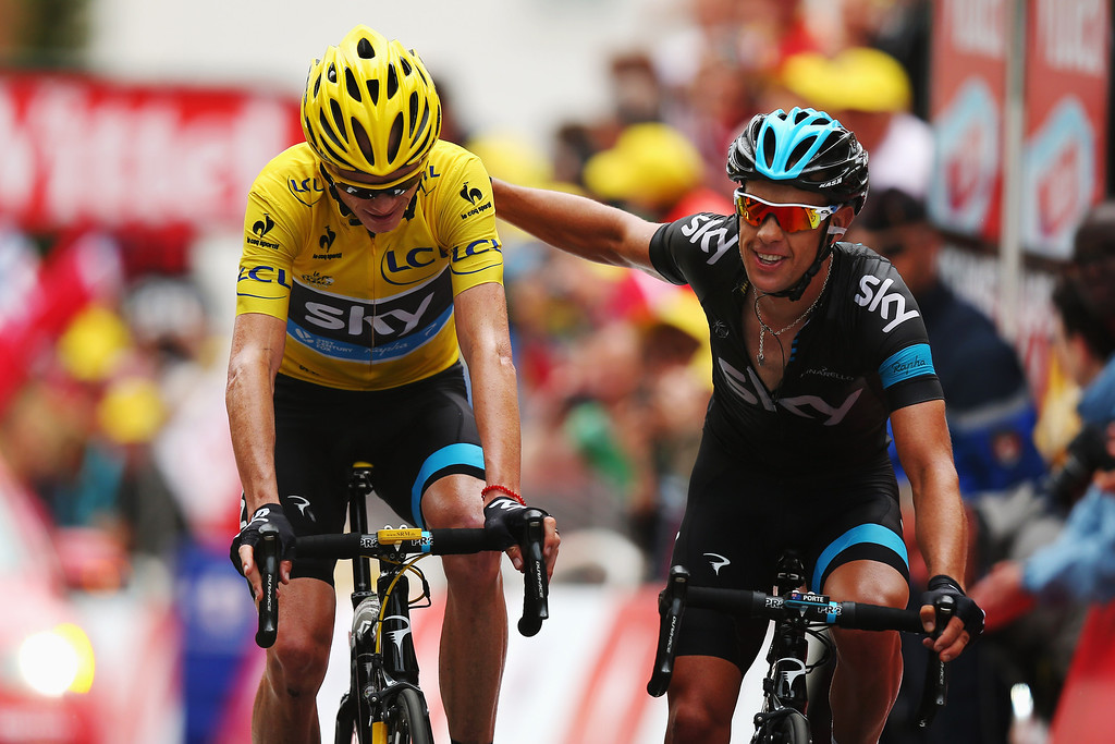 . ALPE D\'HUEZ, FRANCE - JULY 18:  (L-R) Chris Froome of Great Britain and Team Sky Procycling and team mate Richie Porte of Australia cross the finish line together at the end of stage eighteen of the 2013 Tour de France, a 172.5KM road stage from Gap to l\'Alpe d\'Huez, on July 18, 2013 in Alpe d\'Huez, France.  (Photo by Bryn Lennon/Getty Images)