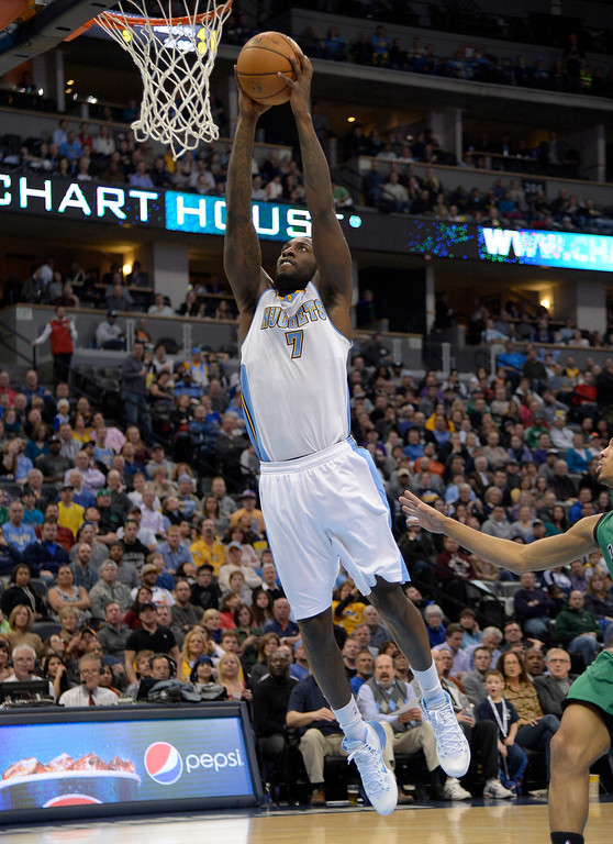 . Denver Nuggets power forward J.J. Hickson (7) goes up for an easy dunk during the second quarter against the Boston Celtics January 7, 2014 at Pepsi Center. (Photo by John Leyba/The Denver Post)