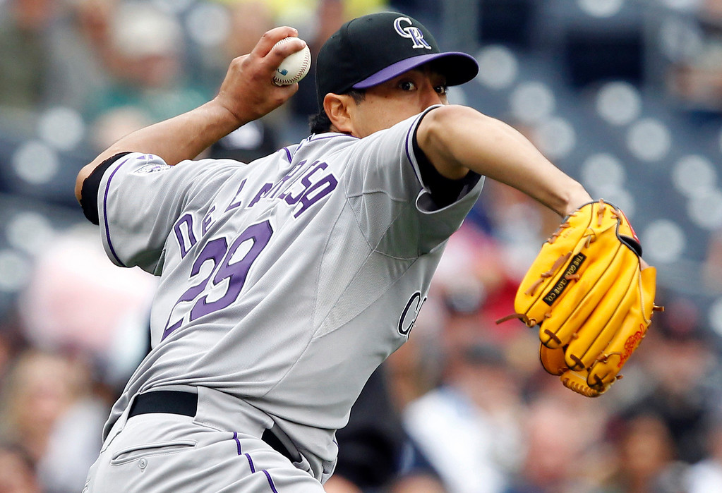 . Colorado Rockies starting pitcher Jorge De La Rosa turns to throw out San Diego Padres\' Everth Cabrera on a ground ball in the sixth inning during a baseball game, Sunday, April 14, 2013, in San Diego. (AP Photo/Alex Gallardo)