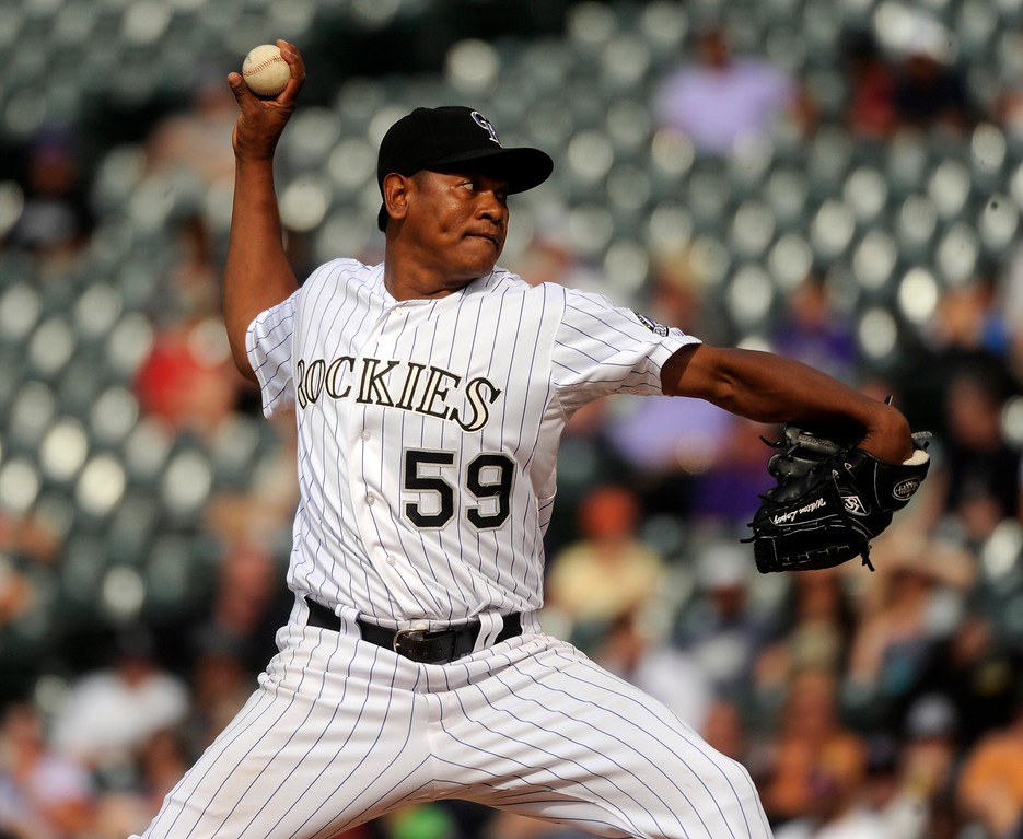 . Colorado reliever Wilton Lopez delivered to the plate in the ninth inning. The Colorado Rockies were defeated by the Miami Marlins 5-3 at Coors Field Thursday afternoon, July 25, 2013. Photo By Karl Gehring/The Denver Post