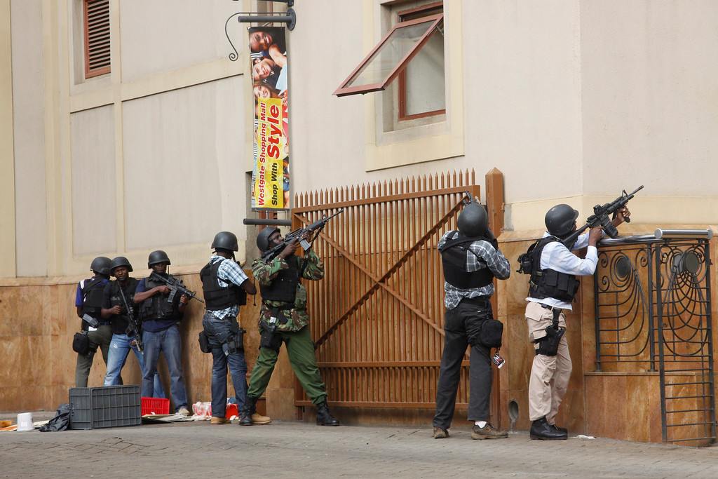 . Armed special forces aim their weapons at the Westgate Mall in Nairobi, Kenya Saturday, Sept. 21, 2013, after gunmen threw grenades and opened fire during an attack that left multiple dead and dozens wounded. (AP Photo/Khalil Senosi)