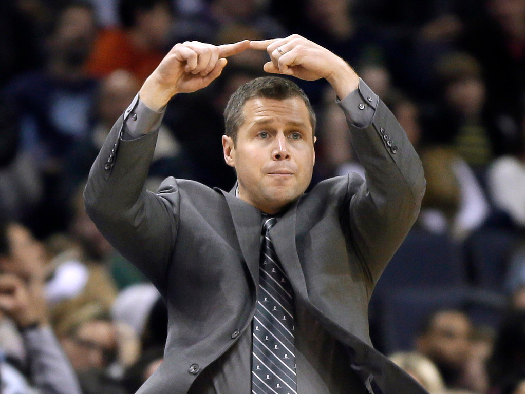 . Memphis Grizzlies coach David Joerger signals to players during the second half of an NBA basketball game against the Denver Nuggets in Memphis, Tenn., Saturday, Dec. 28, 2013. The Grizzlies defeated the Nuggets 120-99. (AP Photo/Danny Johnston)