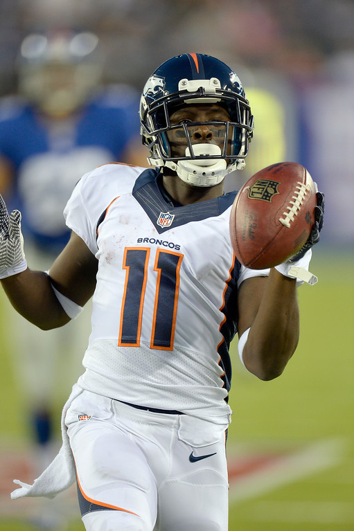 . Denver Broncos wide receiver Trindon Holliday (11) gives a little shake after returning a punt for 81 yards for a touchdown during the fourth quarter September 15, 2013 MetLife Stadium. (Photo by John Leyba/The Denver Post)