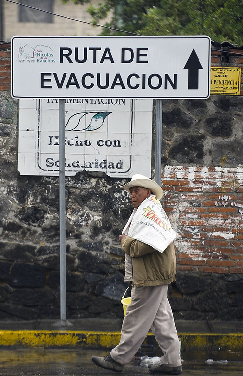 . A man walks in Santiago Xalitzintla community near Popocatepetl volcano, in Puebla, Mexico, on May 13, 2013. According to a report by the National Center of Prevention of Disasters (CENAPRED) the yellow alert phase three is still in force.  Ronaldo Schemidt/AFP/Getty Images