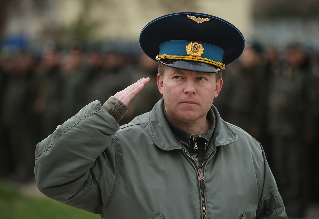 . Colonel Yuli Mamchor, commander of the Ukrainian military garrison at the Belbek airbase, salutes before leading over 100 of his unarmed troops to retake the Belbek airfield from soldiers under Russian command in Crimea on March 4, 2014 in Lubimovka, Ukraine.  (Photo by Sean Gallup/Getty Images)