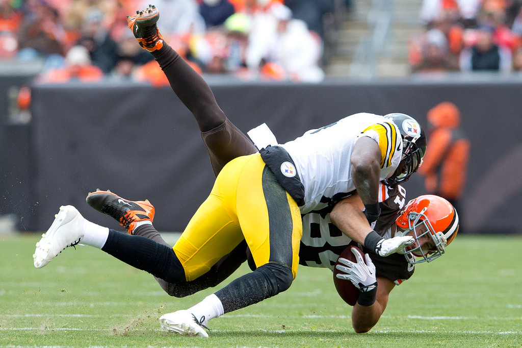 . Inside linebacker Lawrence Timmons #94 of the Pittsburgh Steelers tackles tight end Jordan Cameron #84 of the Cleveland Browns during the first half at FirstEnergy Stadium on November 24, 2013 in Cleveland, Ohio. (Photo by Jason Miller/Getty Images)