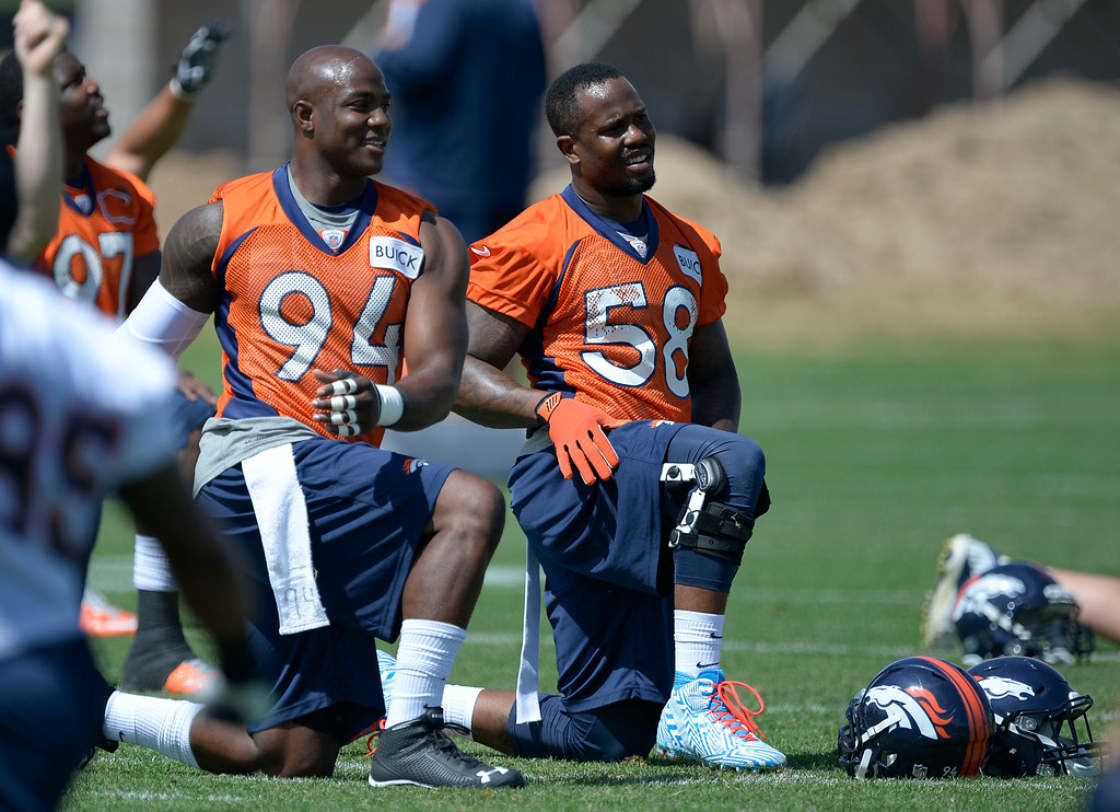 . Denver Broncos DeMarcus Ware (94) and Von Miller (58) stretch during OTAs June 11, 2014 at Dove Valley. (Photo by John Leyba/The Denver Post)