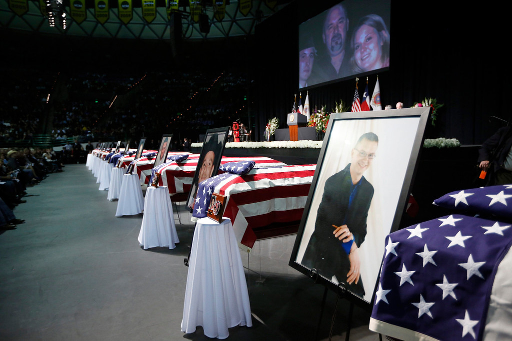 . Coffins containing the remains of victims from the fertilizer plant explosion in the town of West, Texas, are pictured in an auditorium at a memorial for those victims at Baylor University in Waco, Texas, April 25, 2013.  REUTERS/Jason Reed