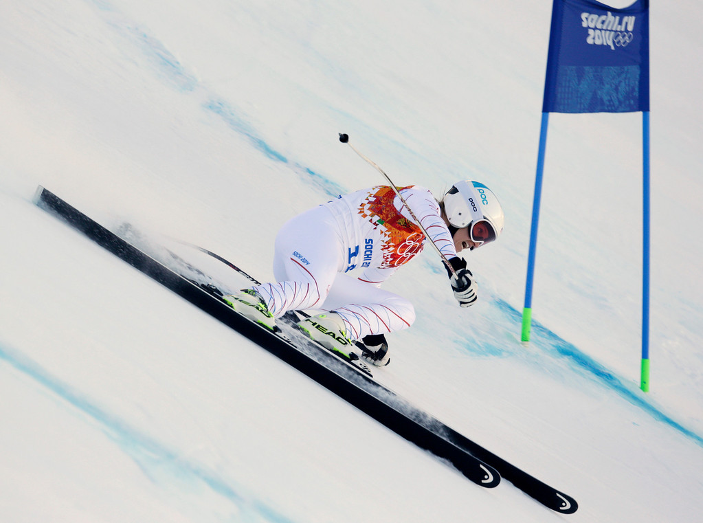 . United States\' Julia Mancuso makes a turn in the women\'s downhill at the Sochi 2014 Winter Olympics, Wednesday, Feb. 12, 2014, in Krasnaya Polyana, Russia. (AP Photo/Charles Krupa)
