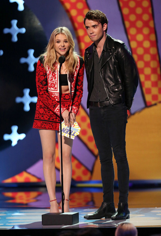 . Chloe Grace Moretz, left, and Jamie Blackley present the award for choice movie actor: sci-fi/fantasy at the Teen Choice Awards at the Shrine Auditorium on Sunday, Aug. 10, 2014, in Los Angeles. (Photo by Matt Sayles/Invision/AP)