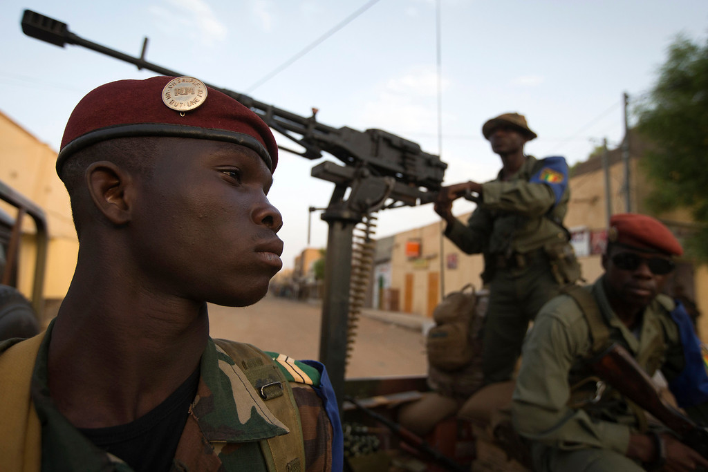 . Malian soldiers take position on a street in Gao on April 13, 2013. The UN Security Council on April 25, 2013 unanimously agreed to send a 12,600-member international force to Mali to take over from French and African troops battling Islamist guerrillas. The United Nations is aiming for a July 1 start by the new force, but the 15-nation council will decide later whether the conflict has eased enough for the handover. Gao fell in March last year to Tuareg rebels who declared the independence of the entire desert north before losing control to armed Islamists. French warplanes bombed parts of Gao in January to drive out fighters from the Movement for Oneness and Jihad in West Africa (MUJAO), and the city was recaptured for the Bamako government by French and Malian forces on January 26. JOEL SAGET/AFP/Getty Images
