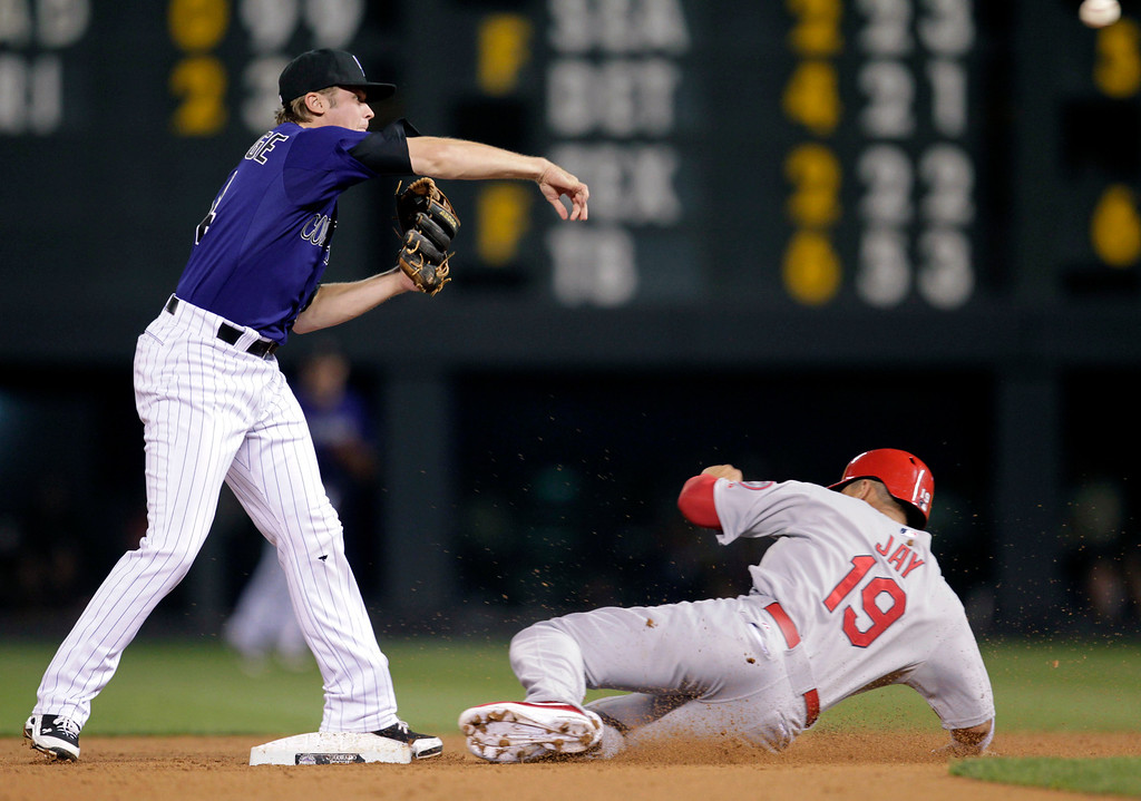 . Colorado Rockies second baseman Josh Rutledge, left, puts out St. Louis Cardinals\' John Jay on a double play during the sixth inning of a baseball game in Denver on Monday, Setp. 16, 2013.(AP Photo/Joe Mahoney)