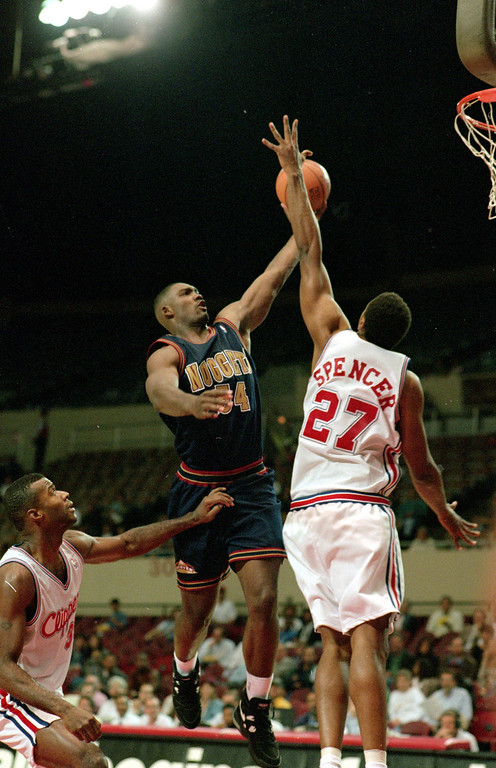 . 1993: Rodney Rogers (No. 9) 19 Oct 1994: Rodney Rogers of the Denver Nuggets makes a layup during a Pre-season game against the Los Angeles Clippers at the LA Sports Arena in Los Angeles, California. Nuggets defeated the Clippers 96-90. J.D. Cuban/Getty Images