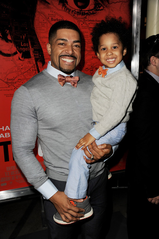 """. Actor/wrestler David Otunga (L) and his son David Otunga, Jr. arrive at the premiere of Tri Star Pictures\' \""""The Call\"""" at the Arclight Theatre on March 5, 2013 in Los Angeles, California.  (Photo by Kevin Winter/Getty Images)"""