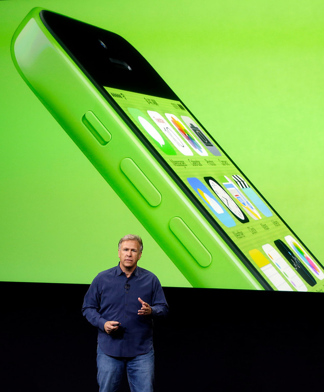 . Phil Schiller, Apple\'s senior vice president of worldwide product marketing, speaks on stage during the introduction of the new iPhone 5c in Cupertino, Calif., Tuesday, Sept. 10, 2013. (AP Photo/Marcio Jose Sanchez)