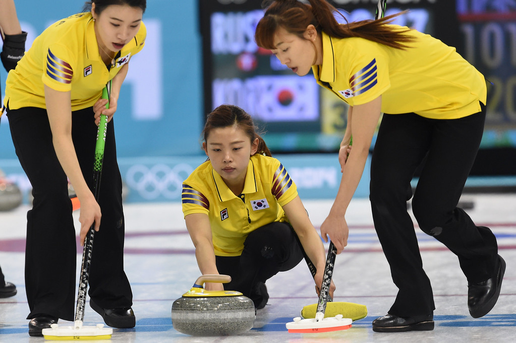 . South Korea\'s Lee Seulbee throws the stone during the Women\'s Curling Round Robin Session 6 match South Korea vs Russia at the Ice Cube Curling Center during the Sochi Winter Olympics on February 13, 2014. DAMIEN MEYER/AFP/Getty Images