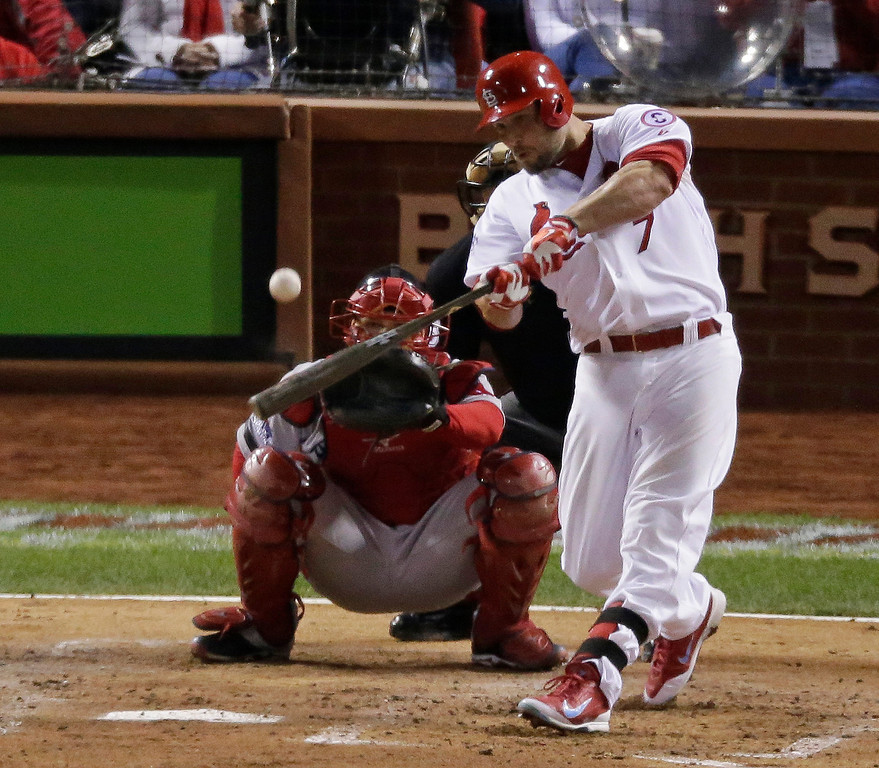. St. Louis Cardinals\' Matt Holliday hits a home run during the fourth inning of Game 5 of baseball\'s World Series against the Boston Red Sox Monday, Oct. 28, 2013, in St. Louis. (AP Photo/Charlie Riedel)
