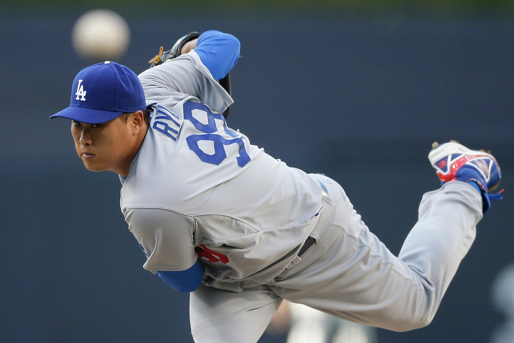. Los Angeles Dodgers starting pitcher Hyun-Jin Ryu pitches to a San Diego Padres batter during the first inning of an opening night baseball game Sunday, March 30, 2014, in San Diego. (AP Photo/Gregory Bull)