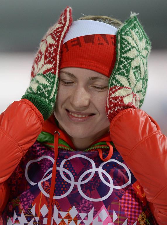 . Darya Domracheva of Belarus celebrates winning the gold medal during the flower ceremony for the Women\'s 12,5km Mass Start competition at the Laura Cross Biathlon Center during the Sochi 2014 Olympic Games, Krasnaya Polyana, Russia, 17 February 2014.  EPA/HENDRIK SCHMIDT