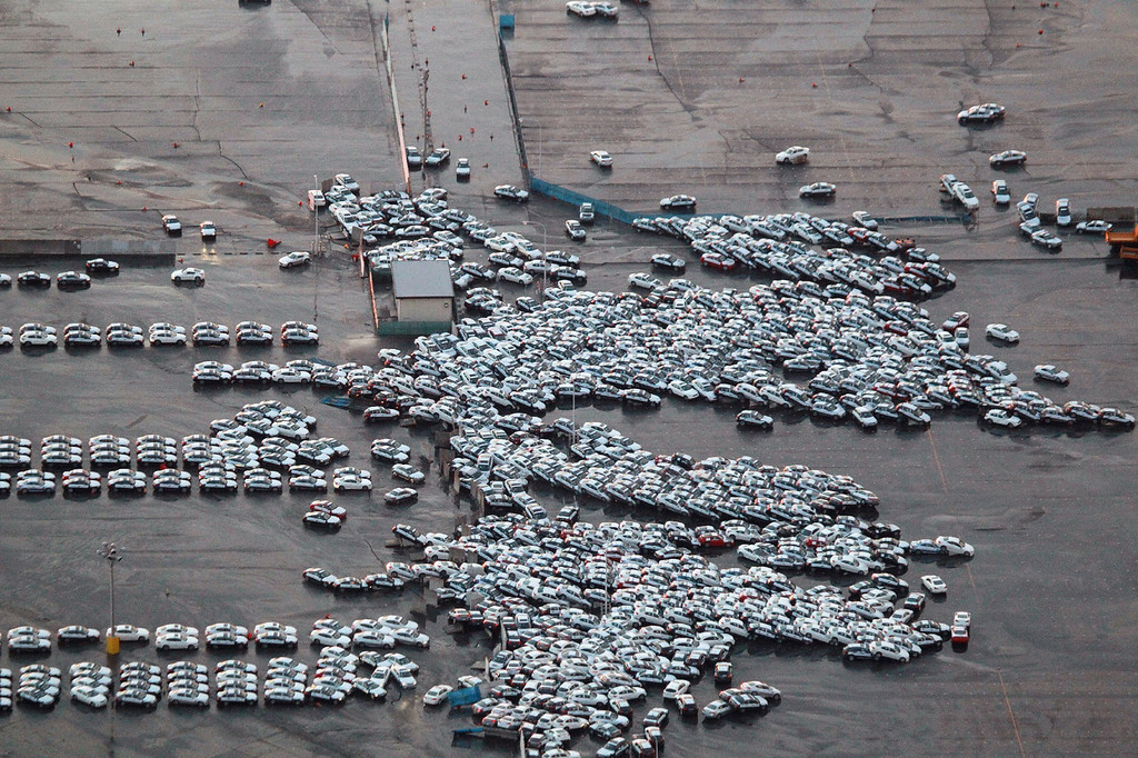 . An aerial shot shows vehicles ready for shipping being carried by a tsunami tidal wave at Hitachinaka city in Ibaraki prefecture on March 11, 2011. A massive 8.8-magnitude earthquake shook Japan, unleashing a powerful tsunami that sent ships crashing into the shore and carried cars through the streets of coastal towns. (STR/AFP/Getty Images)