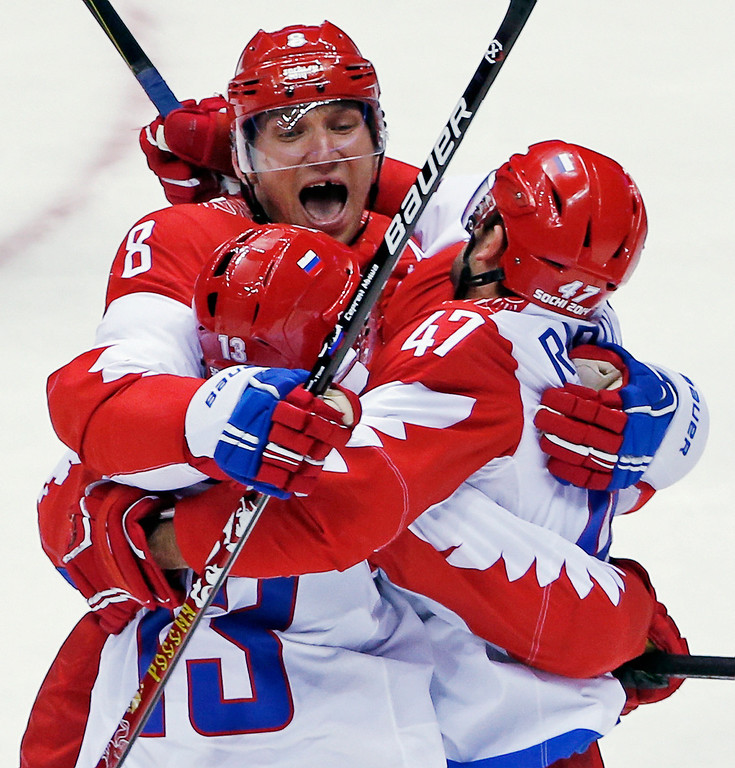 . Russia forward Alexander Ovechkin reacts with forward Pavel Datsyuk after Datsyuk scored a third period goal against the USA during a men\'s ice hockey game at the 2014 Winter Olympics, Saturday, Feb. 15, 2014, in Sochi, Russia. (AP Photo/Petr David Josek)