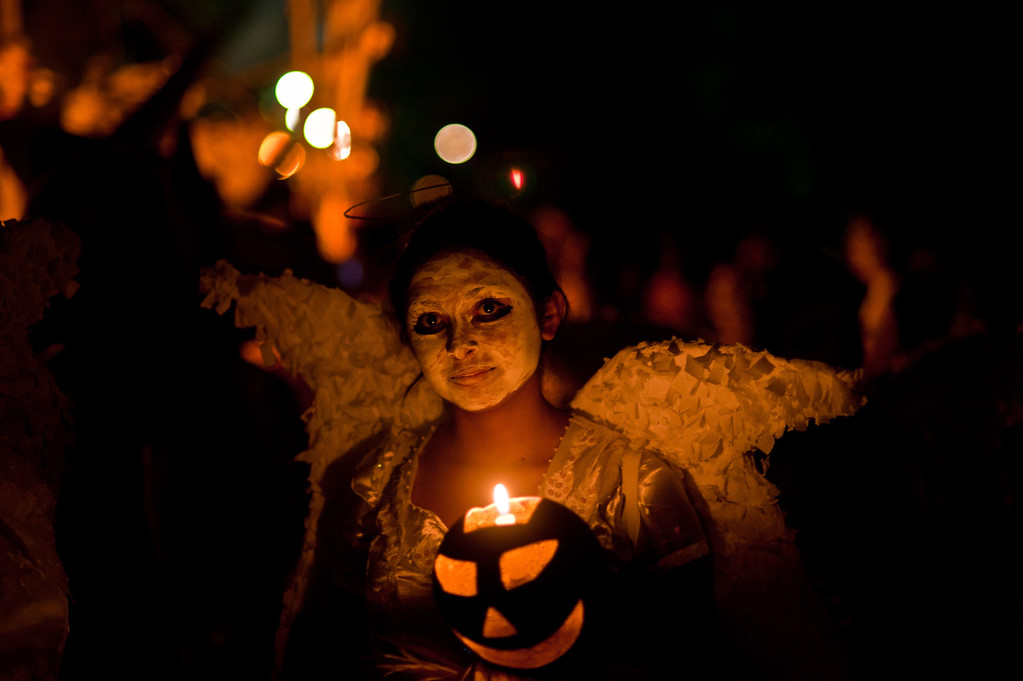 """. A young reveller takes part in a parade called \""""La Calabiuza\"""" on November 1, 2013, on the eve of the Day of the Dead in Tonacatepeque, 20 kms (13 miles) north of San Salvador, El Salvador. During the celebration, the residents of Tonacatepeque, originally an indigenous community, recall the characters of the mythology of Cuscatlan --pre-Columbian west and central regions of El Salvador-- and their dead relatives. Jose CABEZAS/AFP/Getty Images"""