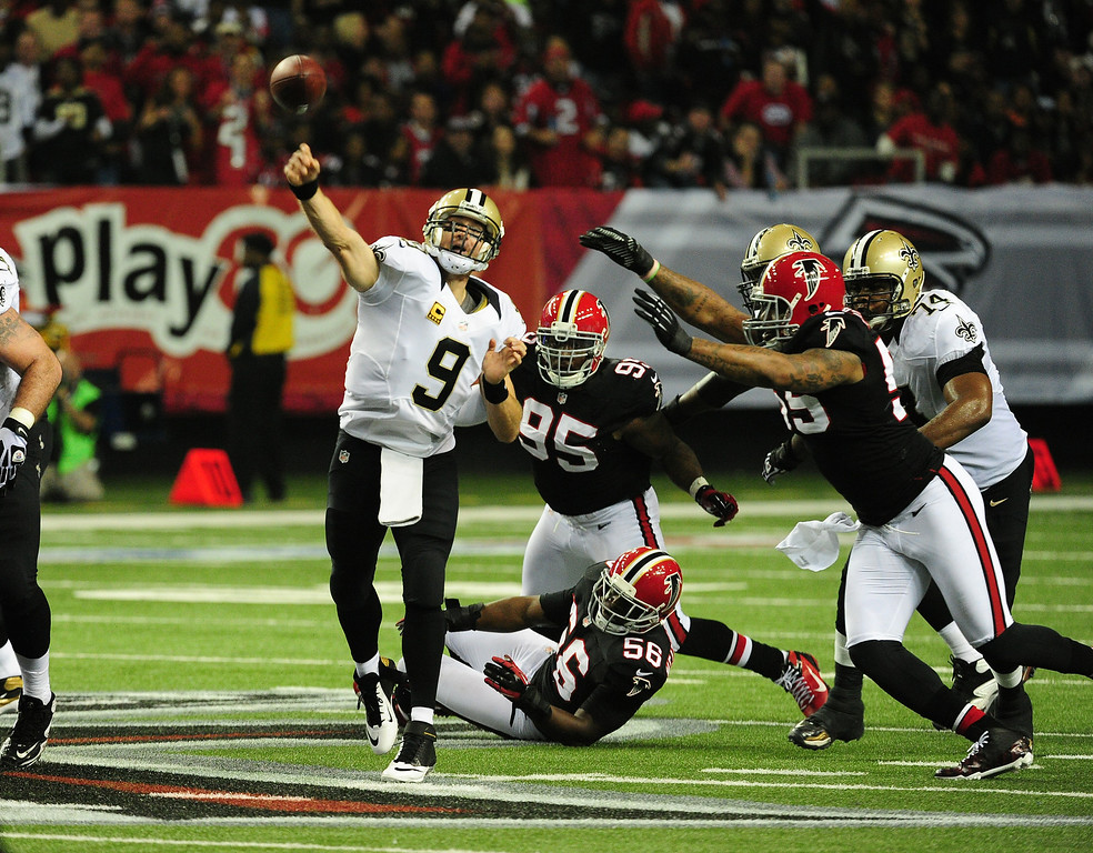 . ATLANTA, GA - NOVEMBER 18:  Drew Brees #9 of the New Orleans Saints passes against the Atlanta Falcons at the Georgia Dome on November 29, 2012 in Atlanta, Georgia  (Photo by Scott Cunningham/Getty Images)