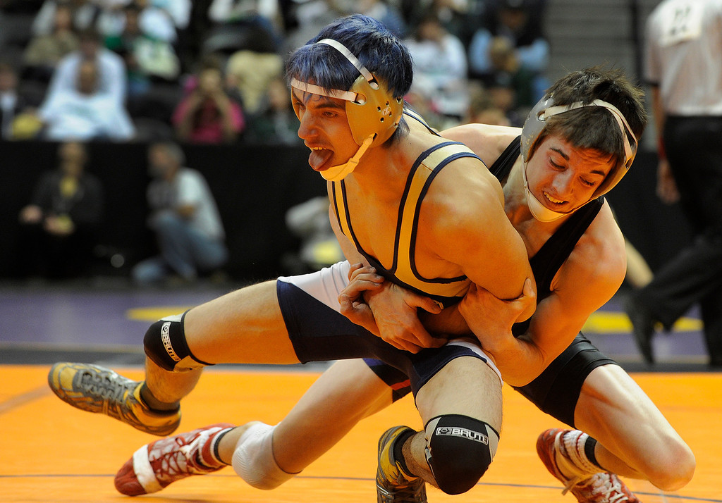. DENVER, CO. - FEBRUARY 21: Baca County wrestler J.D. Chenoweth, right, had Antonito\'s Noah Trujillo, left, in his grasp Thursday. Chenoweth beat Trujillo 12-2 to advance in the 126-pound weight class in 2A. The CHSAA State Wrestling Tournament kicked off Thursday, February 21, 2013 at the Pepsi Center in Denver.  (Photo By Karl Gehring/The Denver Post)