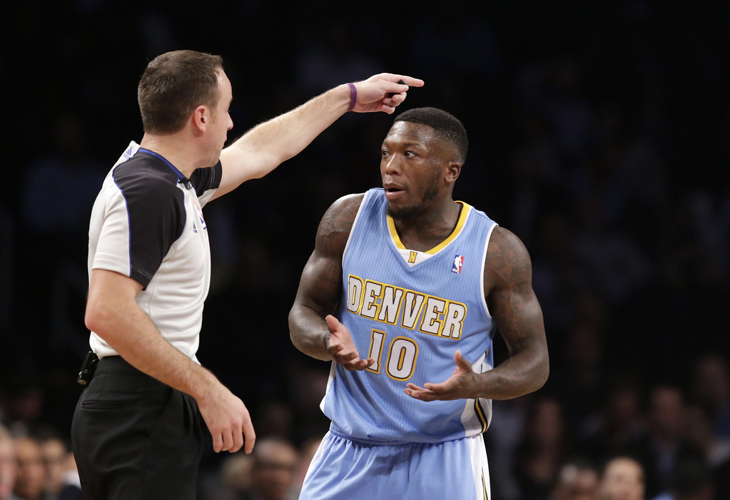 . FILE - In this Dec. 3, 2013 file photo, Denver Nuggets point guard Nate Robinson (10) gestures as a referee tells him the ball goes to the Nets in the first half of an NBA basketball game against the Brooklyn Nets at the Barclays Center in New York. The NBA has fined Nuggets guard Robinson $25,000 for criticizing the officials following Denver\'s 97-95 victory over the Knicks last week. (AP Photo/Kathy Willens, File)