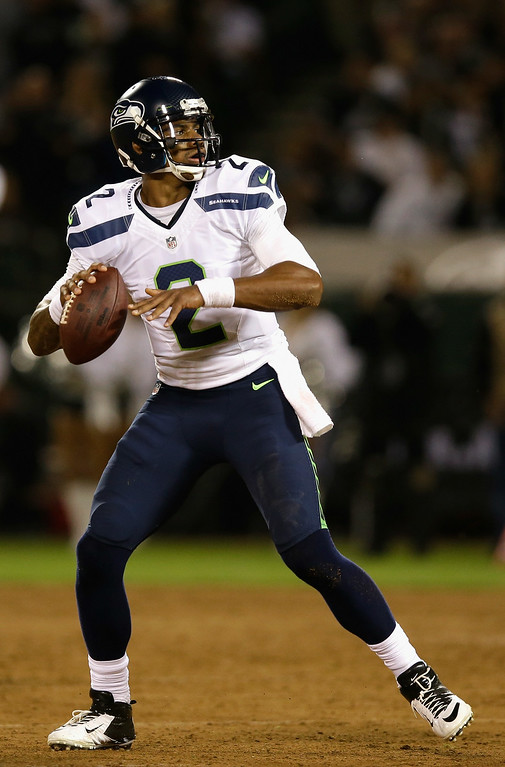 . Terrelle Pryor, QB, Seattle Seahawks Seattle traded for Pryor in April, offering up a seventh-round pick to the Raiders in return. Hoping to be a third quarterback on the team, Pryor was streaky during in the preseason and the team ultimately decided to stick with B.J. Daniels and Tarvaris Jackson behind Russell Wilson. Quarterback Terrelle Pryor #2 of the Seattle Seahawks prepares to pass the ball against the Oakland Raiders during a preseason game at O.co Coliseum on August 28, 2014 in Oakland, California.  (Photo by Ezra Shaw/Getty Images)