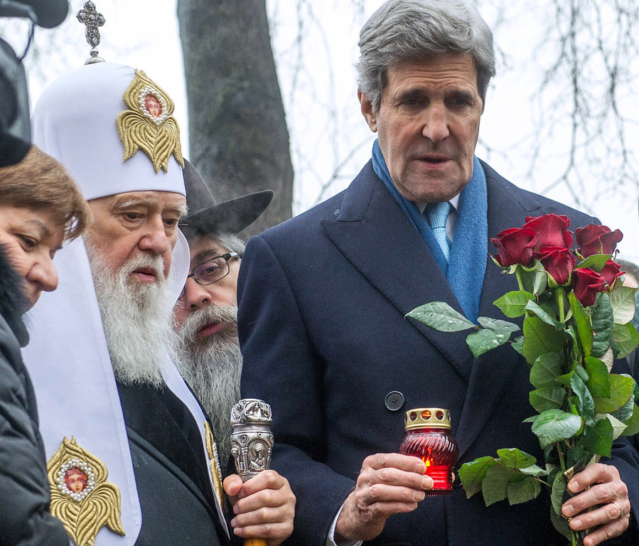. US Secretary of State John Kerry (R) holds a candle during a ceremony at the Shrine of the Fallen in memory of the anti-government protesters killed during the clashes in Kiev on March 4, 2014. Kerry arrived in Kiev for talks with Ukraine\'s new interim government, amid an escalating crisis in Crimea.   AFP PHOTO/ VOLODYMYR  SHUVAYEV/AFP/Getty Images
