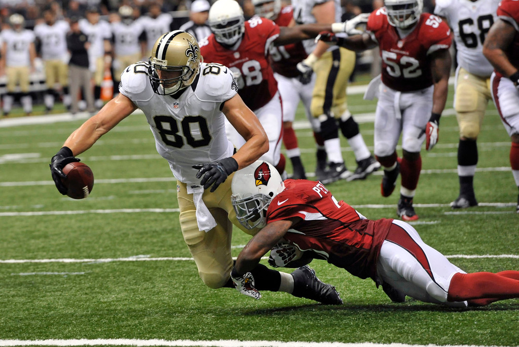 . New Orleans Saints tight end Jimmy Graham (80) reaches over the goal line on a touchdown reception over Arizona Cardinals cornerback Patrick Peterson (21) in the second half of an NFL football game in New Orleans, Sunday, Sept. 22, 2013.(AP Photo/Bill Feig)