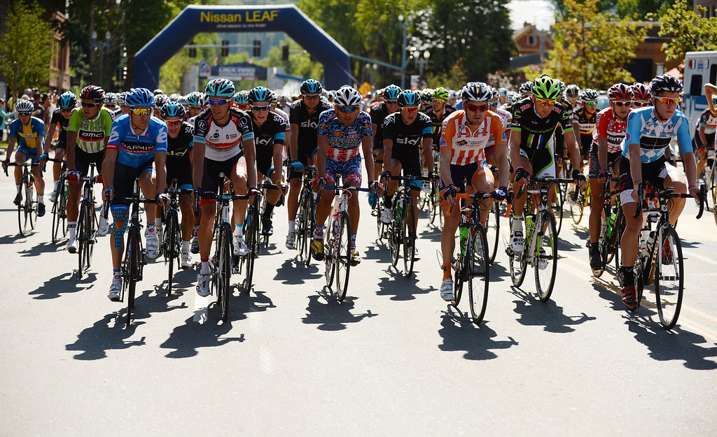. The pack of cyclists leaves downtown Aspen for the start of the 126.4-mile second stage of the 2013 USA Pro Challenge race from Aspen to Breckenridge.(Photo By Hyoung Chang/The Denver Post)