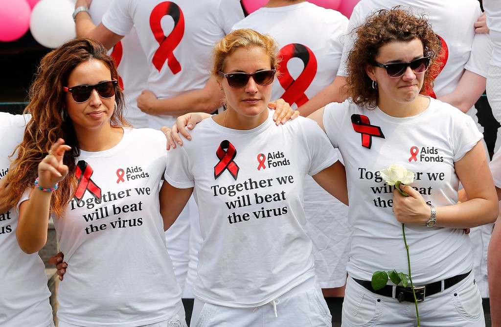 . Members of the Aids Fonds organization pay tribute to the victims of Malaysia Airlines flight MH17 at the start of the Canal Parade of Gay Pride in Amsterdam on August 2, 2014. The plane with 298 people on board came down on July 17 in an area of east Ukraine where pro-Russian separatists are battling government forces. BAS CZERWINSKI/AFP/Getty Images