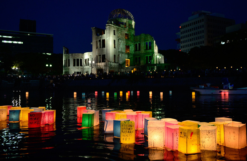 . Paper lanterns lit in remembrance for victims of the 1945 atomic bombing of Hiroshima float on the Motoyasu River in front of the Atomic Bomb Dome at the Peace Memorial Park in Hiroshima, western Japan, on August 6, 2013.  AFP PHOTO / TORU  YAMANAKA/AFP/Getty Images