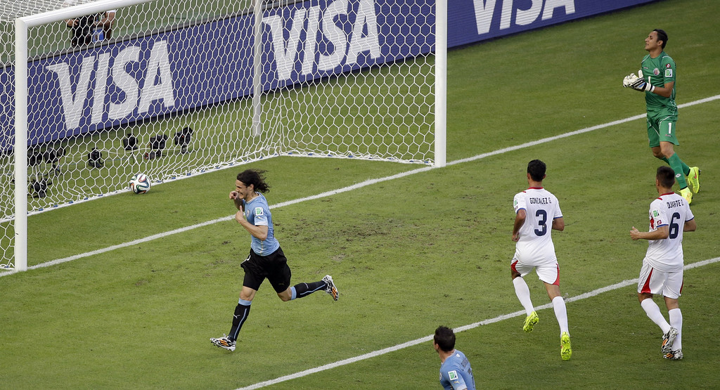 . Uruguay\'s Edinson Cavani, left, celebrates scoring the opening goal during the group D World Cup soccer match between Uruguay and Costa Rica at the Arena Castelao in Fortaleza, Brazil, Saturday, June 14, 2014.  (AP Photo/Sergei Grits)