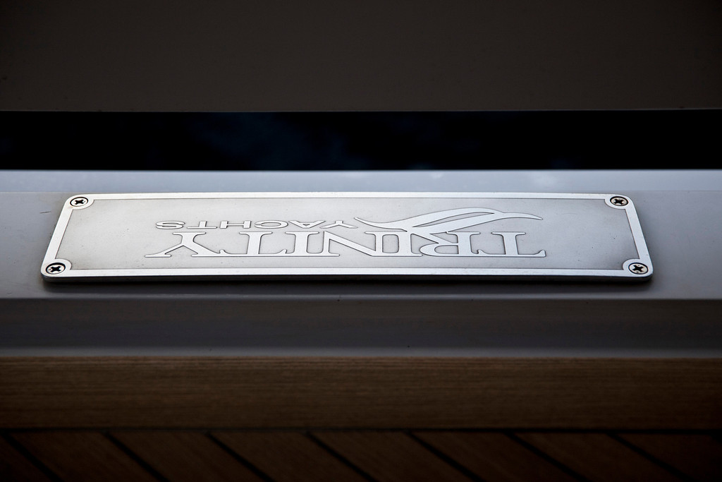 . A Trinity Yachts plaque sits onboard the 190ft (57.9m) motor yacht Mi Sueno, manufactured by Trinity Yachts LLC, as it sits moored in the harbor in Nice, France, on Wednesday, Sept. 25, 2013.  Photographer: Balint Porneczi/Bloomberg