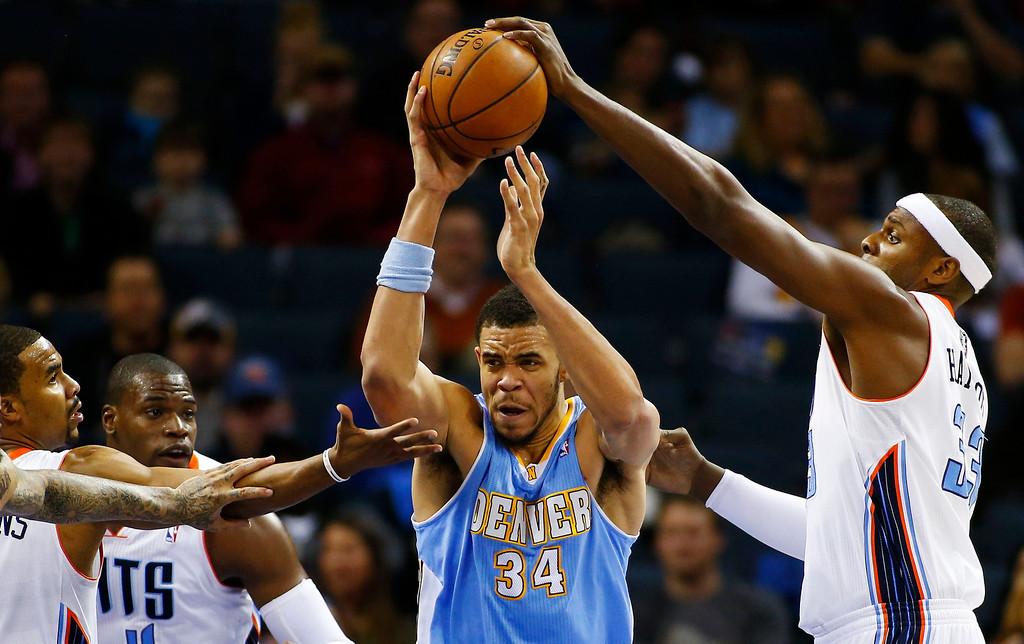 . Denver Nuggets center JaVale McGee (34) works to control the ball against Charlotte Bobcats center Brendan Haywood (R) during the first half of their NBA basketball game in Charlotte, North Carolina February 23, 2013. REUTERS/Chris Keane
