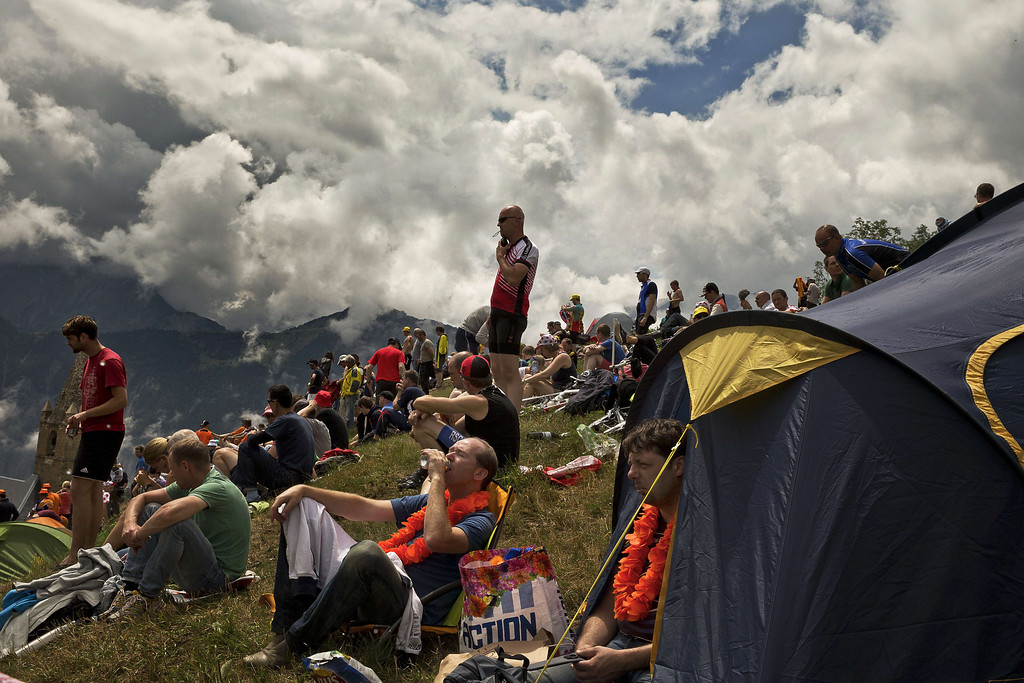 . Dutch supporters wait for riders during the 172.5 km eighteenth stage of the 100th edition of the Tour de France cycling race on July 18, 2013 between Gap and Alpe-d\'Huez, French Alps. JEFF PACHOUD/AFP/Getty Images