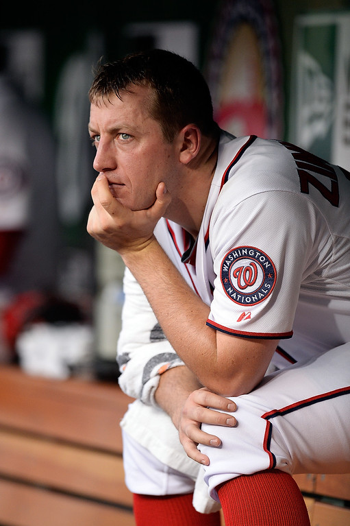 . Starting pitcher Jordan Zimmermann #27 of the Washington Nationals sits in the dugout  in the fourth inning during a game against the Colorado Rockies at Nationals Park on June 20, 2013 in Washington, DC.  (Photo by Patrick McDermott/Getty Images)