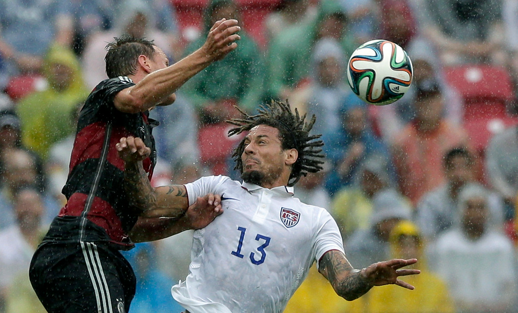 . Germany\'s Benedikt Hoewedes, left, and United States\' Jermaine Jones go for a header during the group G World Cup soccer match between the USA and Germany at the Arena Pernambuco in Recife, Brazil, Thursday, June 26, 2014. (AP Photo/Matthias Schrader)