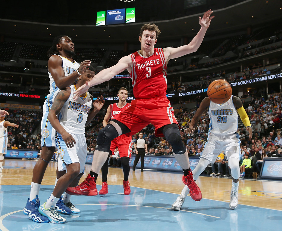 . Houston Rockets center Omer Asik, third from left, of Turkey, loses control of the ball under the basket as, from left, Denver Nuggets forward Kenneth Faried, guard Aaron Brooks and forward Quincy Miller cover in the first quarter of an NBA basketball game in Denver on Wednesday, April 9, 2014. (AP Photo/David Zalubowski)
