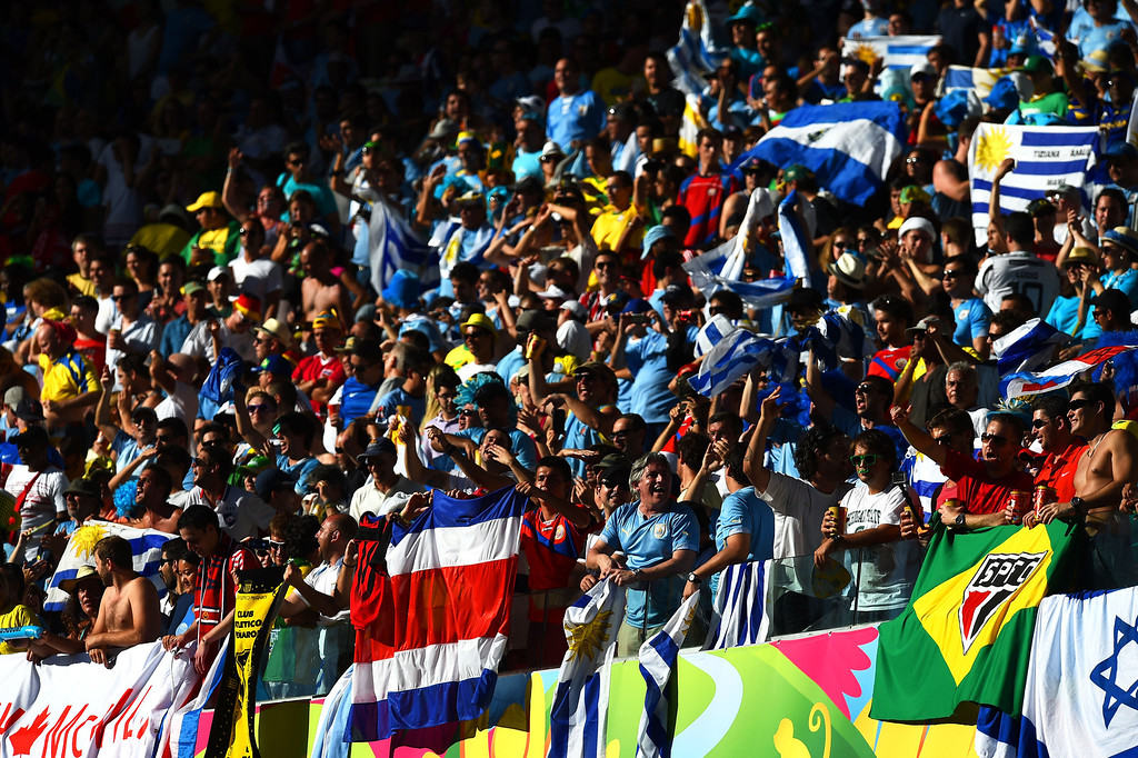 . Fans cheer during the 2014 FIFA World Cup Brazil Group D match between Uruguay and Costa Rica at Castelao on June 14, 2014 in Fortaleza, Brazil.  (Photo by Jamie McDonald/Getty Images)
