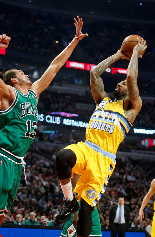 . Denver Nuggets guard Wilson Chandler (21) shoots over Chicago Bulls center Joakim Noah (13) during the first half of an NBA basketball game, Monday, March 18, 2013, in Chicago. (AP Photo/Charles Rex Arbogast)