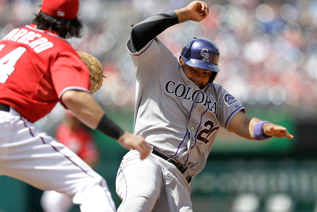 . Colorado Rockies\' Wilin Rosario (20) is out at first after getting caught off base as Washington Nationals first baseman Chris Marrero (14) covers in the fifth inning of a baseball game at Nationals Park, Sunday, June 23, 2013, in Washington. The Rockies won 7-6. (AP Photo/Carolyn Kaster)