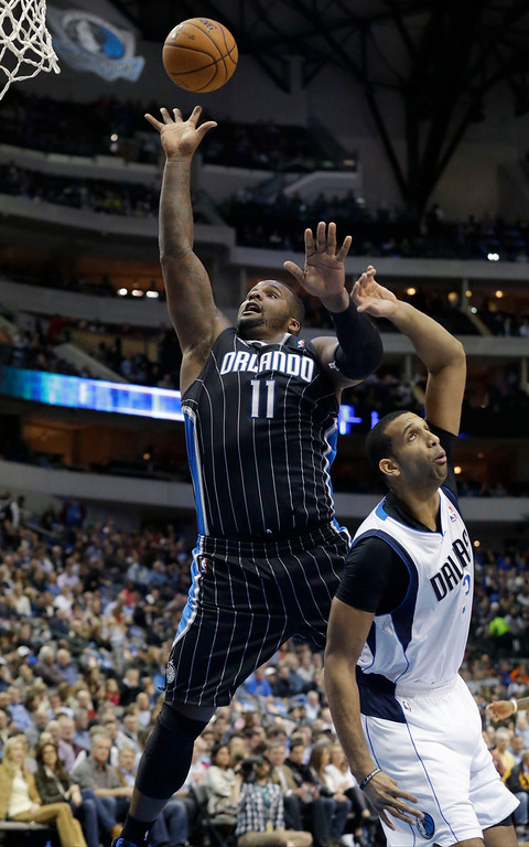 . Orlando Magic power forward Glen Davis (11) shoots over Denver Nuggets point guard Andre Miller (24) during the first half of an NBA basketball game, Monday, Jan. 13, 2014, in Dallas. (AP Photo/LM Otero)