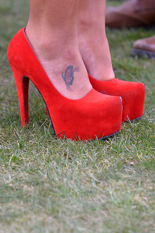 . A racegoer wears Louboutin shoes as they attend Ladies Day, the second day of the Grand National Meeting horse racing event at Aintree Racecourse in Liverpool, north-west England on April 5, 2013. The annual three day meeting culminates in the Grand National which is run over a distance of four miles and four furlongs (7,242 metres), and is the biggest betting race in the United Kingdom.  ANDREW YATES/AFP/Getty Images